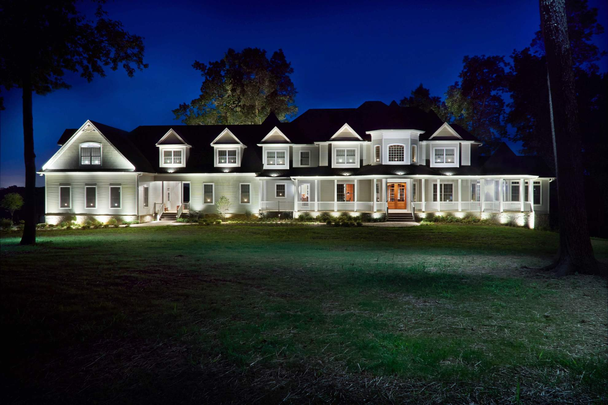 Exterior night shot of home lighting project by Chesapeake Irrigation & Lighting